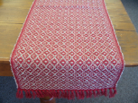 TAN AND RED HONEYCOMB TABLE RUNNER